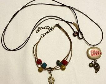 Pretty, ceramic red fern/leaf necklace & beaded bracelet set.