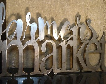 Metal 'Farmers Market' sign that will add an industrial/farmhouse chic feel to any home decor!