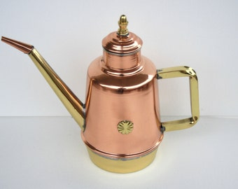 Artisan handcrafted copper oil cruet.