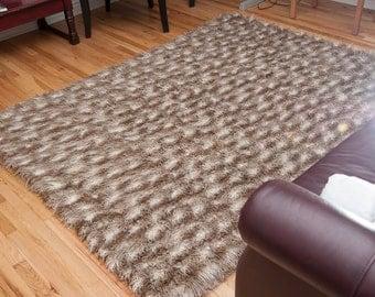 Long pile faux fur rug