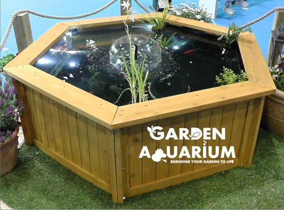Raised hexagon garden fish pond water feature with black for Outdoor fish tank uk