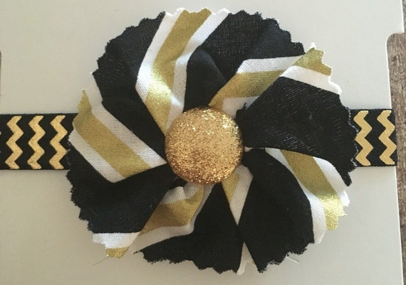 black white and gold chevron print fabric bow on black and