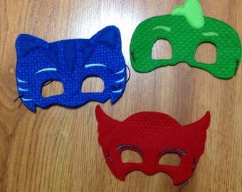 Set of 3 PJ Mask masks. Blue cat boy. Green gecko and red owl girl