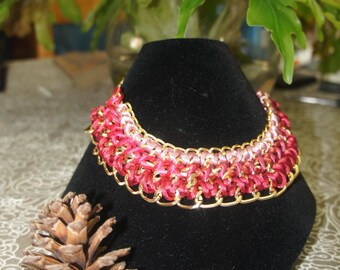 Necklace with gold tone chains and rose tone cord