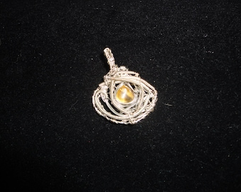 Amber wire wrapped gemstone