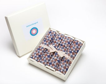 Gift boxed placemats in blue / brown button design