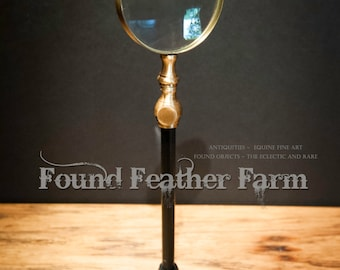 Vintage Magnifying Glass on Black Metal Stand
