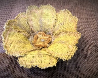 Rustic yellow burlap flower with gold accents