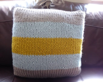 Chunky hand knitted silver grey, pale blue and mustard yellow cushion