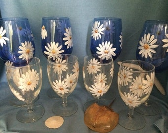 Wine glasses, hand painted with Daisy.
