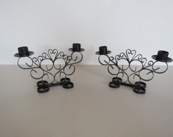 Two black metal chandeliers which represent two vintage hearts, vintage candlesticks, black candlesticks, metal chandeliers,  candle holder