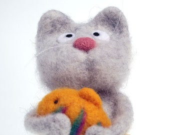 Cute needle felted cat with yellow fish.