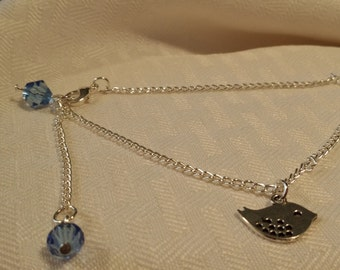 """9"""" Anklet with 2"""" extender Light Blue/Topaz Crystals and Bird Charm"""