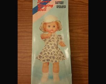 Lora's singing doll