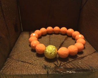 Coral beaded bracelet with gold