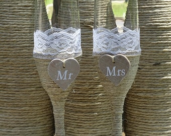 Twine wrapped wedding toasting champagne glasses
