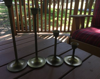 Set of 4 Brass candle sticks