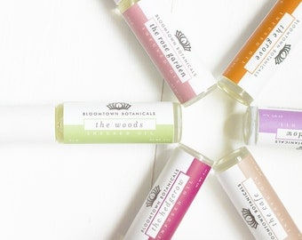Roll On Infused Oils Available in our 6 Signature Bloomtown Scents