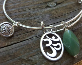 Om adjustable bangle bracelet with Green Aventurine.