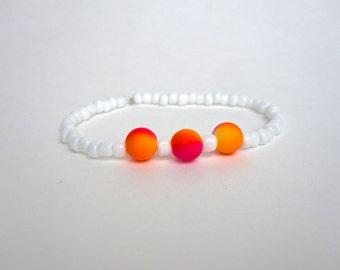Pink orange and white beaded bracelet