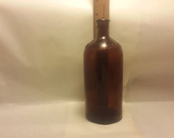 very old brown clorox bottle      C113