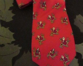 Men's Red Silk Holiday Tie with Santa riding a Reindeer by JOHN HENRY.