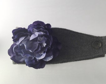 Grey ear warmer with removable blue flower