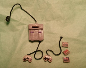 Dollhouse Miniature Super Nintendo with controllers and 4 removable games.  Polymer Clay