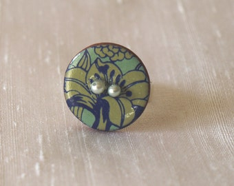 Ring ceramic button