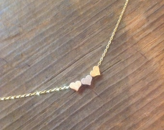 Three small hearts charm necklace