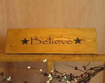 Believe wooden sign