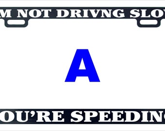 I 'm not driving slow I'm speeding funny assorted license plate frame