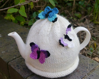Cream Hand Knitted Tea Cosy With Crochet Butterflies