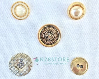 Elegant metal and plastic buttons . Ideal for dresses, fashion accessories and handcrafts.
