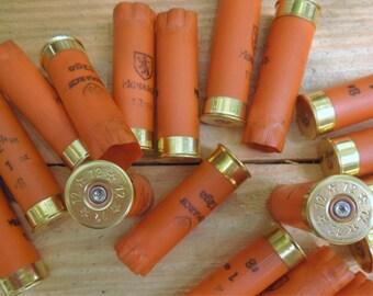 "Shotgun shells (12 size lot) ""CLEMSON ORANGE""/Monarch 12 gauge empty/once fired shotgun shells."