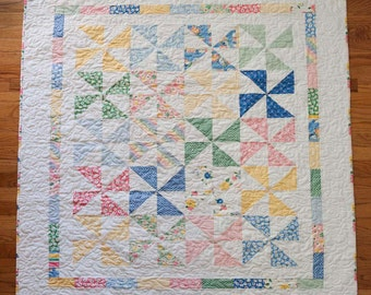 "Pinwheel baby quilt - pink, blue, yellow, green 48"" x 56"""