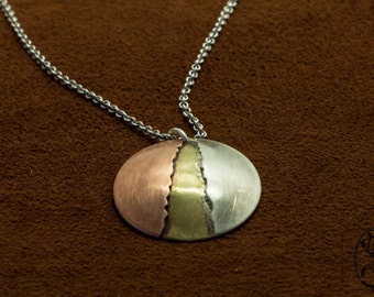 Unique Handmade Metal Tear Pendant made from Brass, Copper and Sterling Silver