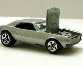 Vintage 1982 replica 67 Camaro Hot Wheels.