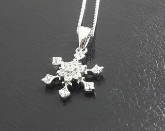 Sterling silver cz snowflake pendant with chain.