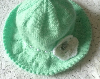 Hand knit baby sunhat with flower