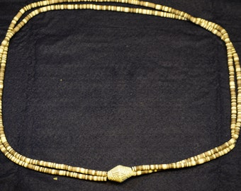 Long earth-tone plastic beaded necklace