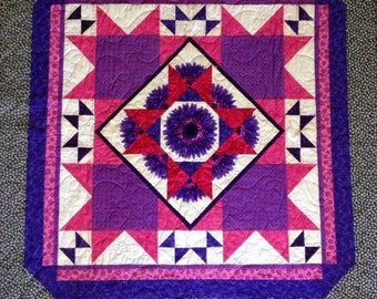 Purple and pink flower quilt