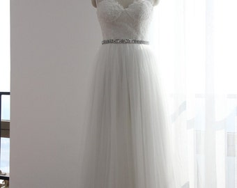 Spaghetti Straps support the lace bodice with Tulle skirt and detachable jeweled belt