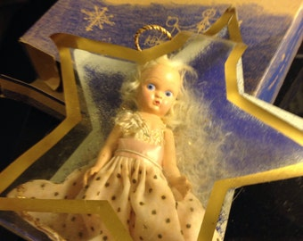 A Virga Doll in original packaging and box- antique doll