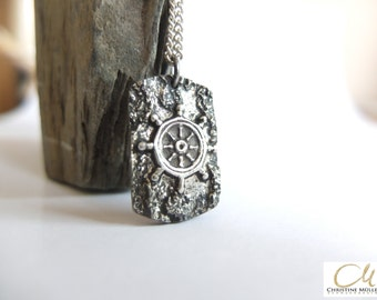 Dog tag pendant with steering wheel, made of solid silver, blackened, with a coarse texture. Made to their own design handmade.