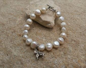 Freshwater pearl sterling silver charm bracelet
