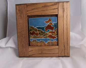 Ceramic landscape art tile with tree water and hills
