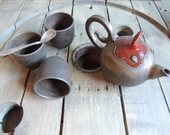Teapot service in stoneware, bronze and red ash