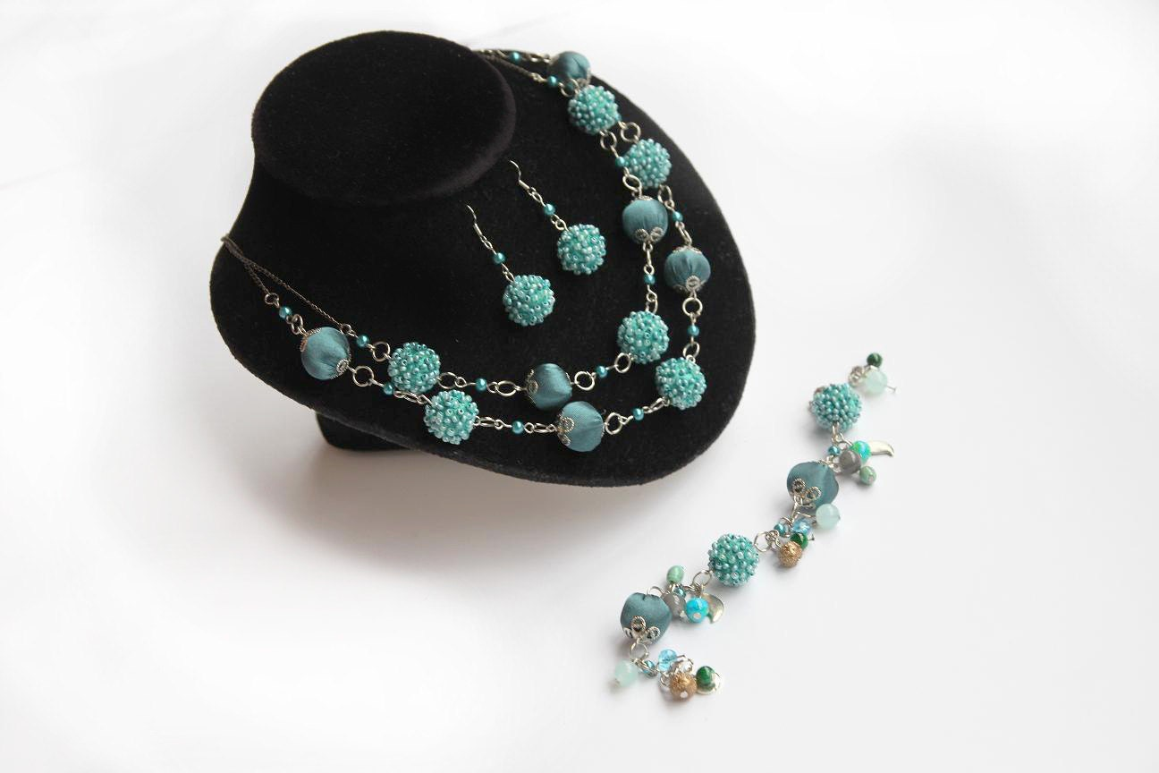 Turquoise costume jewelry fabric turquoise by for Turquoise colored fashion jewelry