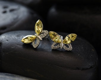 Swarovski crystal Jonquil butterfly stud earrings finished in glossy rhodium
